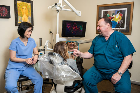 Woman getting a dental exam by Dr. Gary J. Jacky at Perrinville Family Dentistry in Edmonds, WA