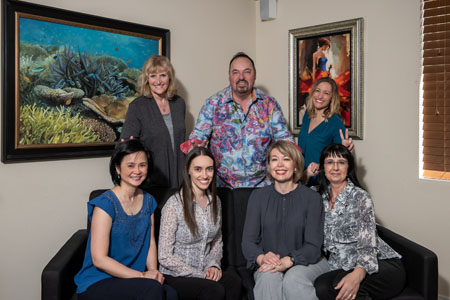 The staff at Perrinville Family Dentistry in Edmonds, WA smiling.