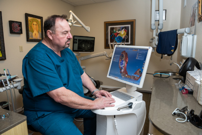 Picture of Doctor Dr. J. Jacky, DMD with Cerec technology at Perrinville Family Dentistry, Edmonds, WA